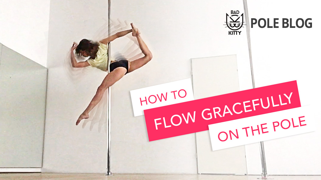 A graceful pole dancer performing the ballerina spin